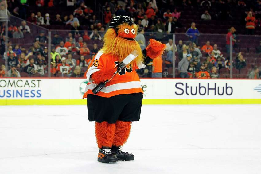 The Philadelphia Flyers mascot, Gritty, takes to the ice during the first intermission of the Flyers' preseason NHL hockey game against the Boston Bruins, Monday, Sept, 24, 2018, in Philadelphia.