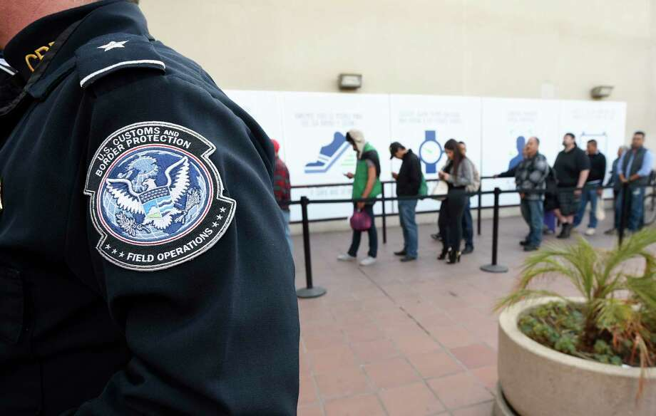 "FILE - In this Dec. 10, 2015, file photo, pedestrians crossing from Mexico into the United States at the Otay Mesa Port of Entry wait in line in San Diego. The Trump administration is proposing rules that could deny green cards to immigrants if they use Medicaid, food stamps, housing vouchers and other forms of public assistance. The Department of Homeland Security said Saturday, Sept. 22, 2018, that current and past receipt of certain public benefits above thresholds will be considered ""a heavily weighed negative factor"" in granting green cards as well as temporary visas. Photo: Denis Poroy, AP / FR59680 AP"