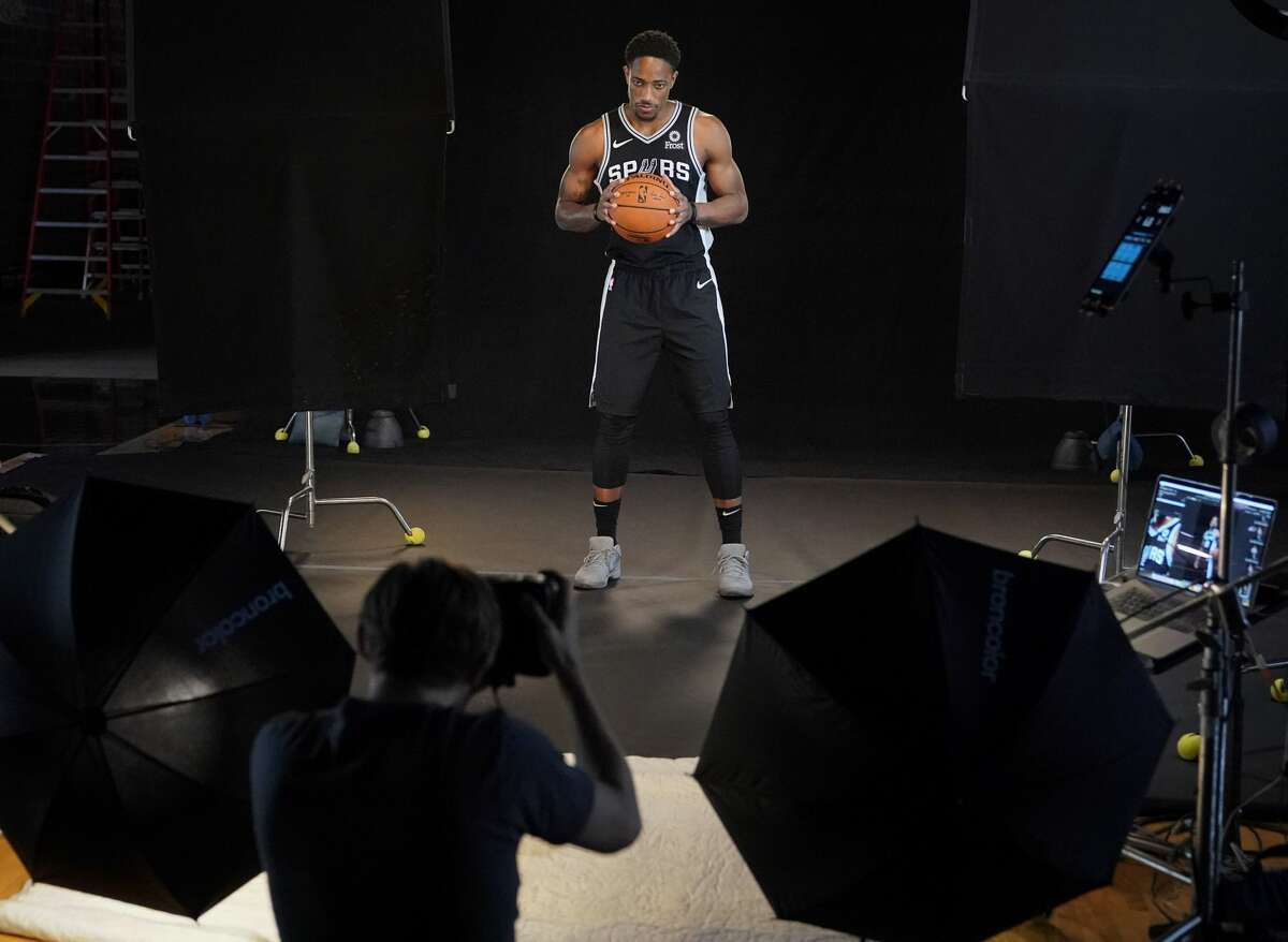 San Antonio Spurs guard DeMar DeRozan poses for photographs during media day at the Spurs practice facility in San Antonio, Monday, Sept. 24, 2018. (AP Photo/Darren Abate)