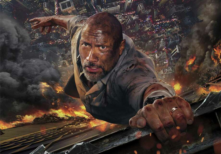 """It's another day at the office for Dwayne Johnson in """"Skyscraper."""" Photo: Universal Pictures / © 2018 Universal. All Rights Reserved."""