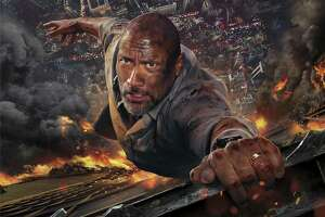 """It's another day at the office for Dwayne Johnson in """"Skyscraper."""""""