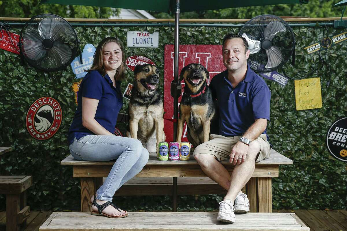 Henderson Heights owners Megan and Steve Long, along with their dogs, Chloe and Rocky, have launched Good Boy Dog Beer, a pork, chicken or vegetable based beverage for dogs Thursday Sept. 20, 2018 in Houston.