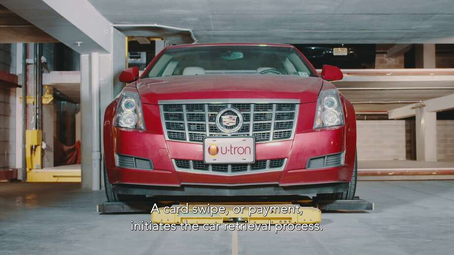The U-Tron automated parking system parks and retrieves cars without using a human valet.  Photo: U-tron