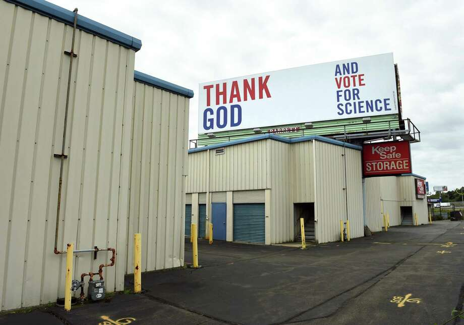 One of a series of three billboards incorporating religion, science and voting to travelers on southbound I-95 in West Haven on Thursday. Photo: Arnold Gold / Hearst Connecticut Media / New Haven Register