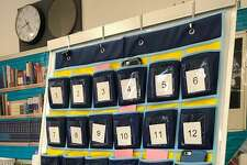 Westhill High School last year began using pockets for students to store their cellphones during class.