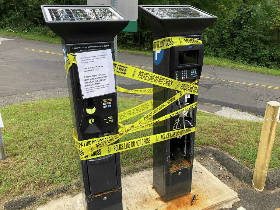 The two parking machines vandalized at Talmadge Hill Road parking lot. Photo: Humberto J. Rocha / Hearst Connecticut Media / New Canaan News