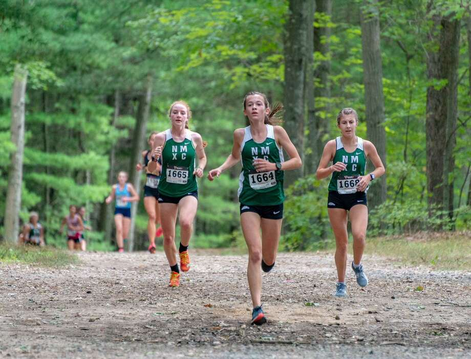 From left, Katie Delaney, Claire Daniels and Brooke Morabito get out in front of the pack at the Winding Trails Invitational on Saturday. Photo: Gerard Bianchi / Contributed Photo / Gerard Bianchi