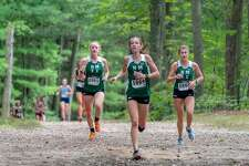 From left, Katie Delaney, Claire Daniels and Brooke Morabito get out in front of the pack at the Winding Trails Invitational on Saturday, Sept. 22, 2018.