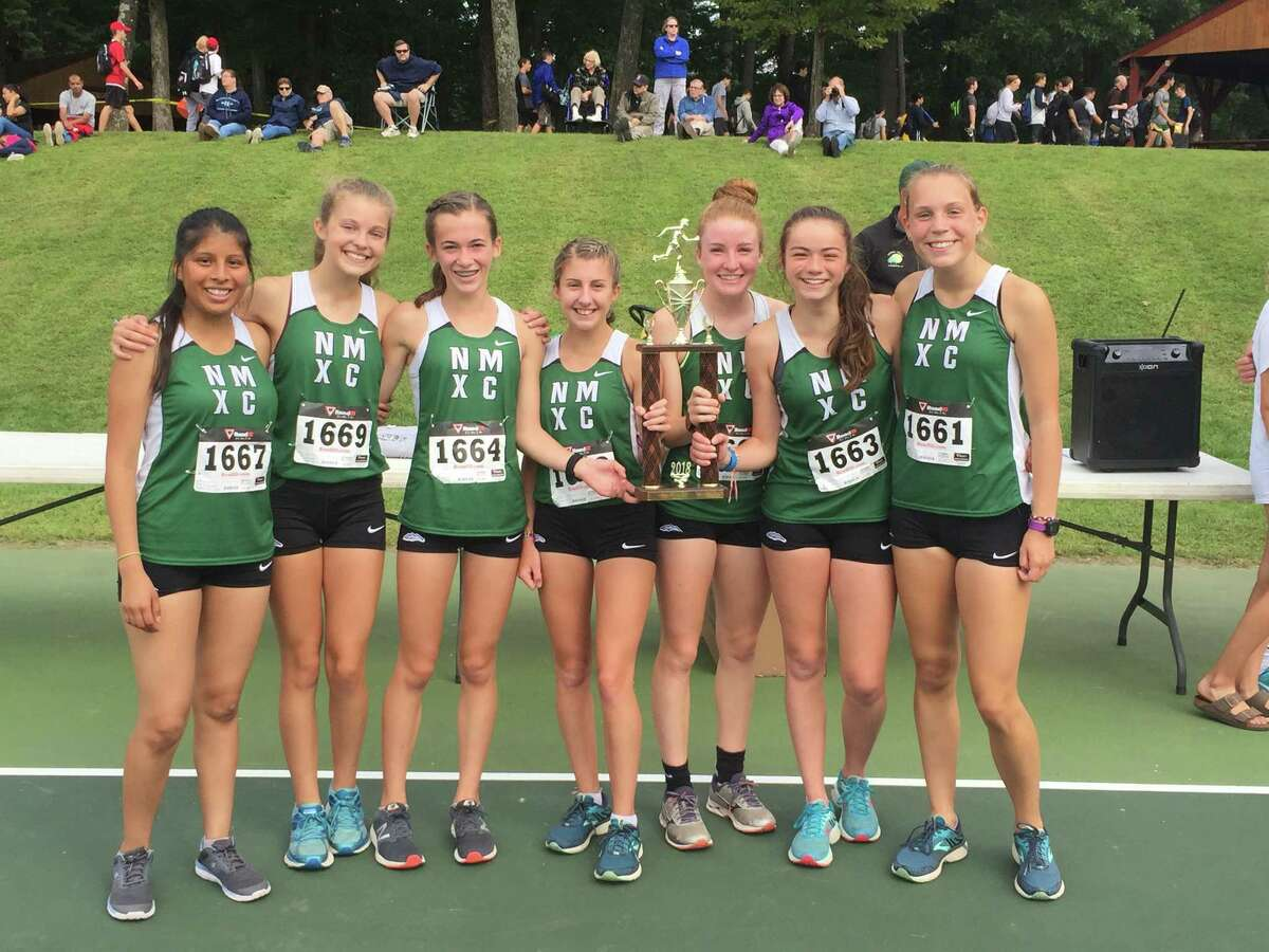 The New Milford Girls Cross Country Team (from left) Britney Flores, Shannon Palmer, Claire Daniels, Brooke Morabito, Katie Delaney, Julia Colley, Jessica Baranowski, won the Winding Trails Invitational on Saturday, Sept. 22, 2018 in Farmington. The Green Wave finished 1,2,3,8 and 28 to win the event with a score of 42.