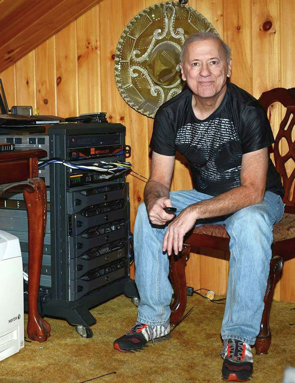 Tom Tryniski at home in Fulton, NY in his newspaper digitization nerve center, which dominates his livingroom.