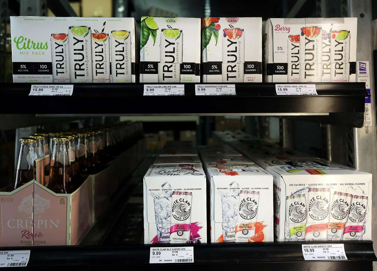 White Claw Hard Seltzer and Truly Spiked & Sparkling are seen in a cooler at Binny's Beverage Depot on N. Marcey Street in Chicago on Wednesday, Sept. 19, 2018. (Terrence Antonio James/Chicago Tribune/TNS)