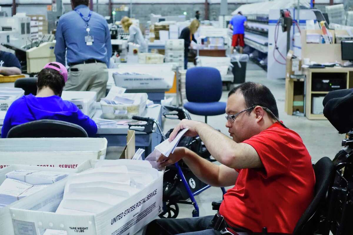 Rich Whaley, a mail processing clerk at the Center for Disability Services mail fulfillment center, works on a job at the center on Tuesday, Sept. 25, 2018, in Albany, N.Y. (Paul Buckowski/Times Union)