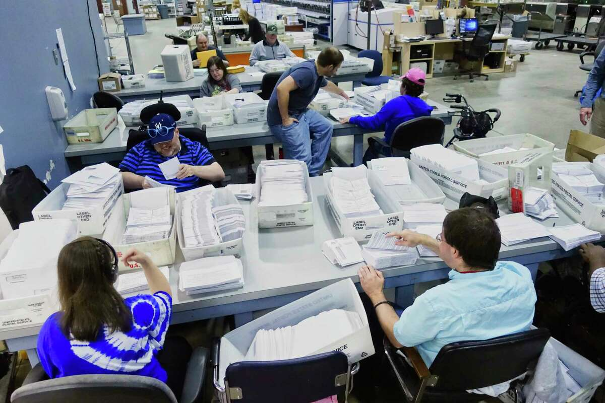 Mail processing clerks at the Center for Disability Services mail fulfillment center, work on jobs at the center on Tuesday, Sept. 25, 2018, in Albany, N.Y. (Paul Buckowski/Times Union)