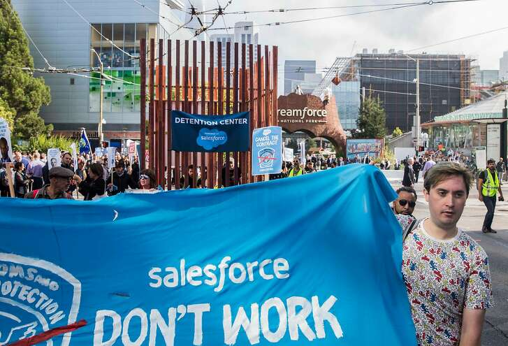Protesters with Fight for the Future walk down 4th Street with a large cage installation calling for an end to Salesforce's contract with Customs and Border Patrol outside the Dreamforce conference hosted by Salesforce in downtown San Francisco, Calif. Tuesday, Sept. 25, 2018.