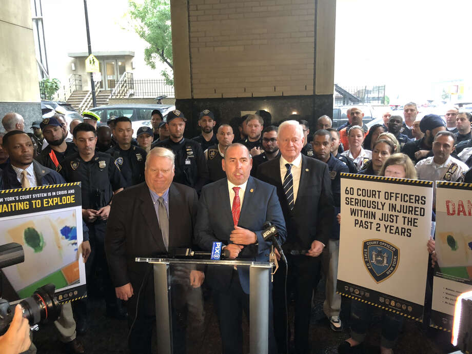 """[L-R] Dennis Quirk, president New York State Court Officers Association; Patrick Cullen, president of New York State Supreme Court Officers Association, and state Sen. Marty Golden, R-Brooklyn, call for the state's Office of Court Administration to designate more resources towards security before implementation of """"Raise the Age"""" in October. Photo: [Photo Courtesy Of Stuart Marques]"""