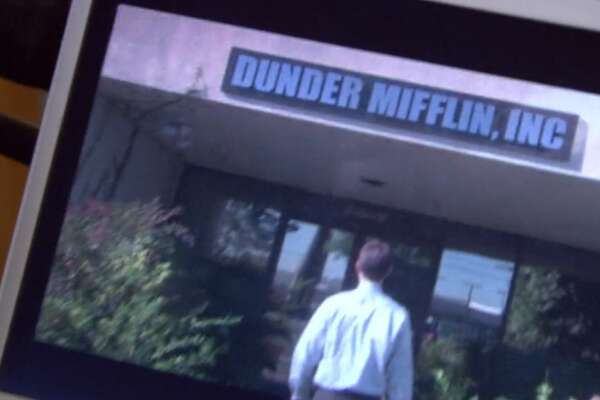 "Items from the hit TV show ""The Office"" go up for auction. Pictured: The Dunder Mifflin exterior sign."
