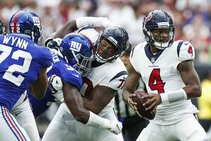 Houston Texans quarterback Deshaun Watson (4) drops back to pass against the New York Giants during the second quarter of an NFL football game at NRG Stadium on Sunday, Sept. 23, 2018, in Houston.