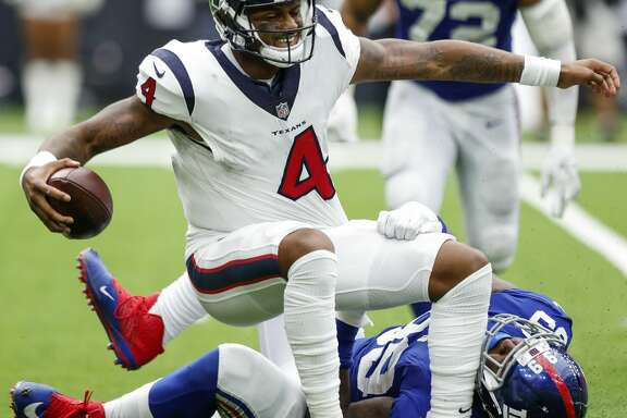 Houston Texans quarterback Deshaun Watson (4) is sacked by New York Giants defensive end Mario Edwards (99) during the fourth quarter of an NFL football game at NRG Stadium on Sunday, Sept. 23, 2018, in Houston.