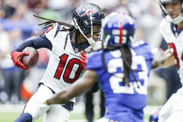 Houston Texans wide receiver DeAndre Hopkins (10) looks for a lane as he runs the ball during the second half as the Houston Texans take on the New York Giants at NRG Stadium Sunday Sept. 23, 2018 in Houston.