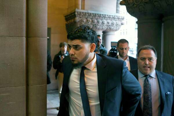 """Houston Astros' Roberto Osuna arrives at court, Tuesday, Sept. 25, 2018 in Toronto. An assault charge against pitcher Roberto Osuna has been dropped. In exchange, he agreed Tuesday to a one-year """"peace bond,"""" requiring him to not contact the woman and to continue counseling.Chris Young/The Canadian Press via AP)"""