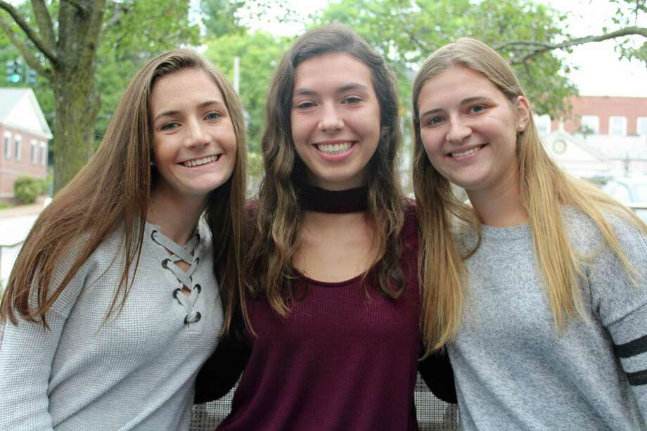 From left, Caroline Cioffi, Andie Carroll and Olivia Flaherty-Lovy, editors in chief of the NCHS paper, the NCHS Courant. Photo: Humberto J. Rocha / Hearst Connecticut Media / New Canaan News