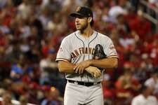 San Francisco Giants starting pitcher Madison Bumgarner walks back to the mound after giving up an RBI single to St. Louis Cardinals' Marcell Ozuna during the first inning of a baseball game Friday, Sept. 21, 2018, in St. Louis. (AP Photo/Jeff Roberson)