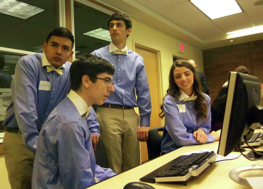 A team from Fairfield Warde High School competes in the Junior Achievement High School Business Challenge staged at Fairfield University in 2014. Photo: John Burgeson / File Photo / Connecticut Post