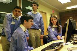 A team from Fairfield Warde High School competes in the Junior Achievement High School Business Challenge staged at Fairfield University in 2014.
