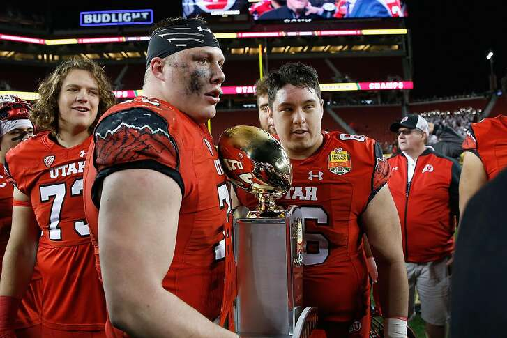 SANTA CLARA, CA - DECEMBER 28: Garett Bolle #72 and Kyle Lanterman #66 of the Utah Utes with the trophy after a win against the Indiana Hoosiers in the Foster Farms Bowl game at Levi's Stadium on December 28, 2016 in Santa Clara, California. (Photo by Lachlan Cunningham/Getty Images)