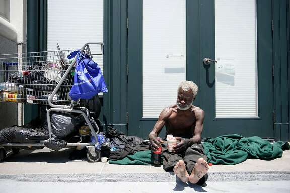 Jerry Womack, who has been homeless for 8 years, eats some food as he sits in a doorway on Van Ness Street near Market in San Francisco, Calif., on Thursday May 31, 2018.