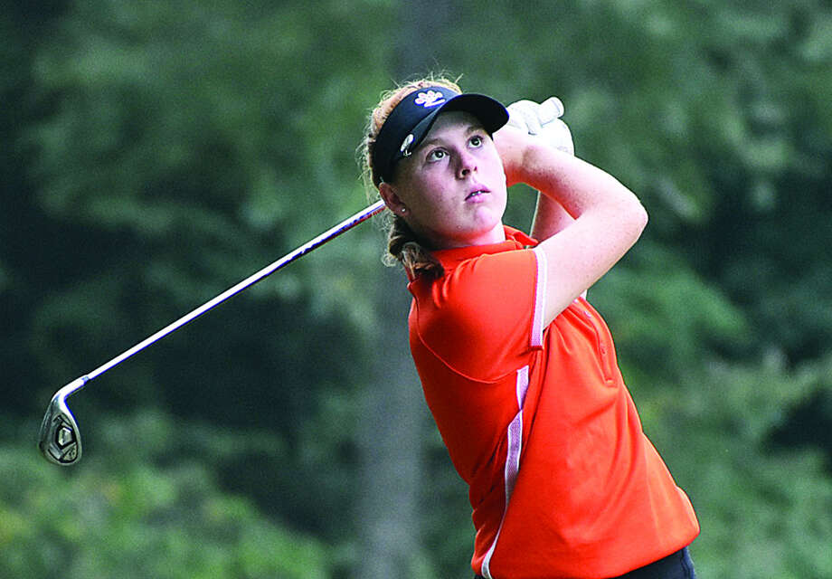 Edwardsville's Riley Lewis watches her approach shot on Hole No. 15 at Far Oaks Golf Club on Tuesday in Swansea. Photo: Matthew Kamp