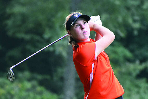 Edwardsville's Riley Lewis watches her approach shot on Hole No. 15 at Far Oaks Golf Club on Tuesday in Swansea.