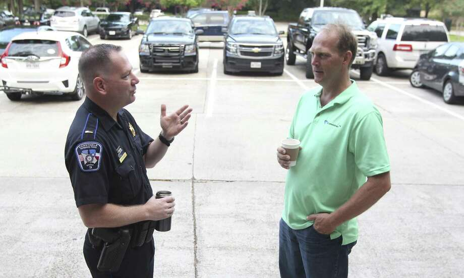 Lt. Mike Atkins, left, speaks with Rob Dushek during Coffee with Cops where officers with the Montgomery County Precinct 3 Constable's Office visited with residents at Third Gen Coffee on Thursday, July 12, 2018, in The Woodlands. Photo: Jason Fochtman, Staff Photographer / Houston Chronicle / © 2018 Houston Chronicle