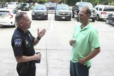 Lt. Mike Atkins, left, speaks with Rob Dushek during Coffee with Cops where officers with the Montgomery County Precinct 3 Constable's Office visited with residents at Third Gen Coffee on Thursday, July 12, 2018, in The Woodlands.