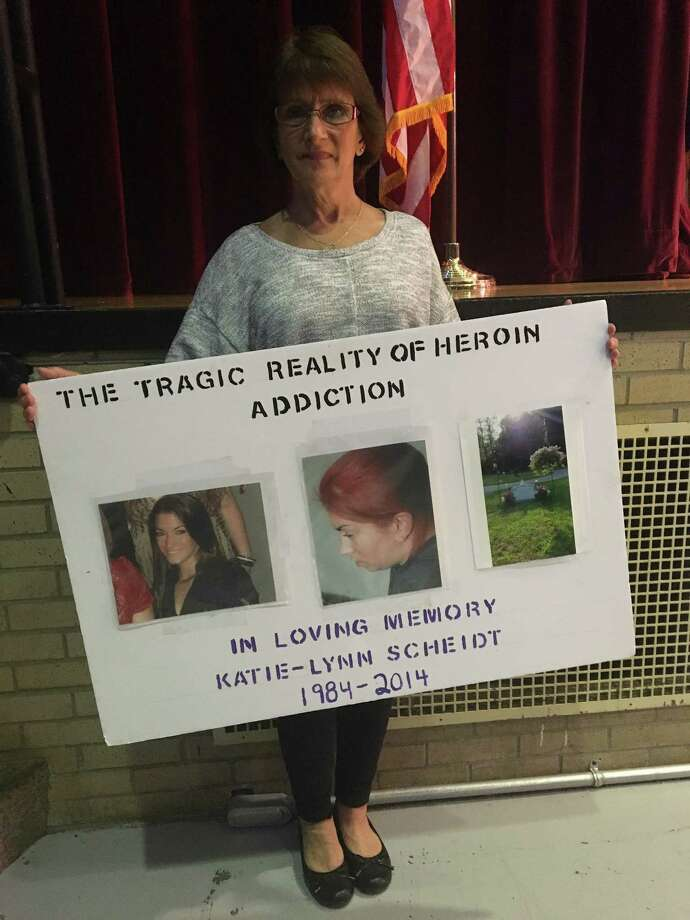 Eve Cascone of Wilton holds a poster with three pictures of her daughter Katie-Lynn Scheidt - before her opioid addiction, while on drugs, and her grave after she overdosed four years ago. Cascone shared her daughter's story at an opioid awareness event at Niskayuna High School on Monday, September 24, 2018. Photo: By Mallory Moench