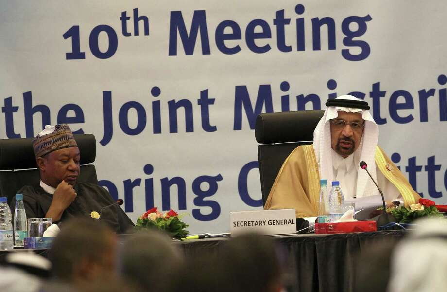 Khalid Al-Falih, Minister of Energy, Industry and Mineral Resources of Saudi Arabia, right, and Mohammed Sanusi Barkindo, OPEC Secretary-General, left, speak during OPEC's 10th meeting of the Joint Ministerial Committee to monitor the oil production reduction agreement of the Organization of the Petroleum Exporting Countries, OPEC, and non-OPEC members, in Algiers, Algeria, Sunday, Sept. 23, 2018. NEXT: The killing of a journalist in a Saudi Arabian consulate threatens to upend an uneasy energy balance.  Photo: Anis Belghoul, STR / Associated Press / Copyright 2018 The Associated Press. All rights reserved.