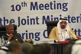 Khalid Al-Falih, Minister of Energy, Industry and Mineral Resources of Saudi Arabia, right, and Mohammed Sanusi Barkindo, OPEC Secretary-General, left, speak during OPEC's 10th meeting of the Joint Ministerial Committee to monitor the oil production reduction agreement of the Organization of the Petroleum Exporting Countries, OPEC, and non-OPEC members, in Algiers, Algeria, Sunday, Sept. 23, 2018. (AP Photo/Anis Belghoul)