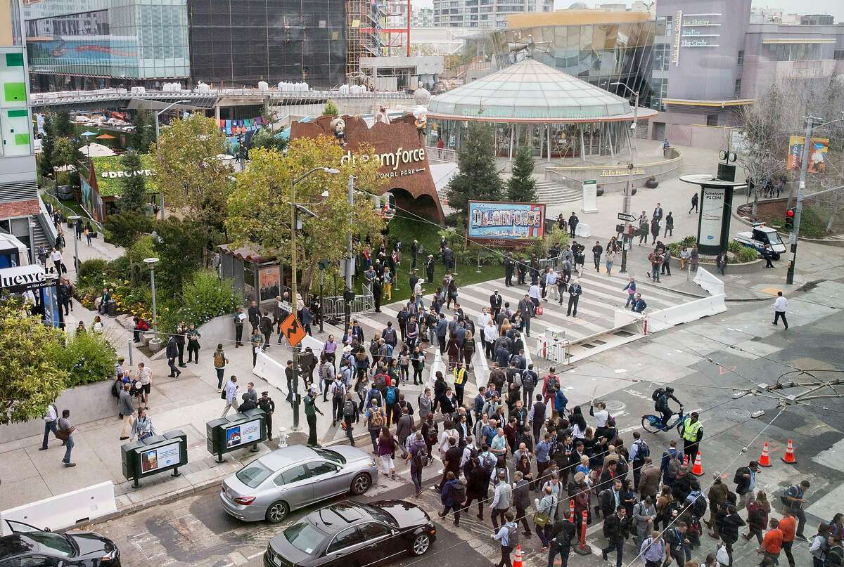 Crowds of people cross 4th Street at Howard Street during the Dreamforce conference hosted by Salesforce in downtown San Francisco, Calif. Tuesday, Sept. 25, 2018.
