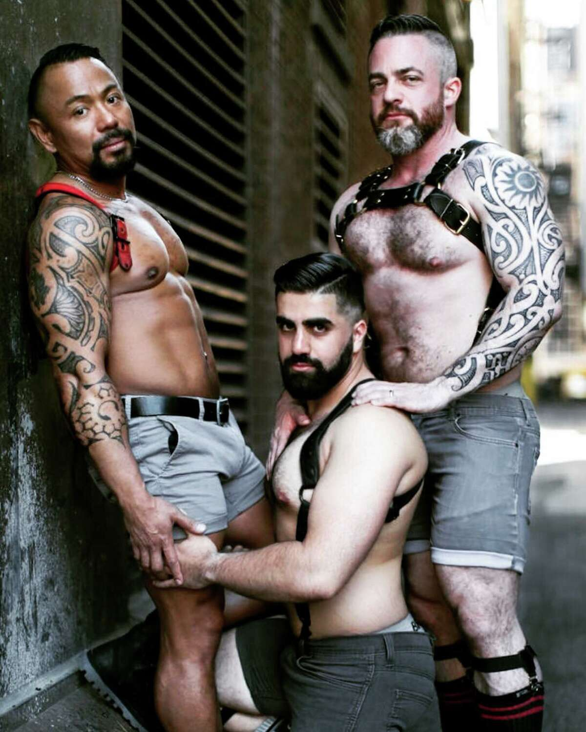 Andy Wibbels (right), a Folsom Street Fair enthusiast, will be going to his 10th fair this weekend. Here he poses with Ron Zamora (left) and Sunny Gill (center) in a photoshoot for one of the weekend's events.