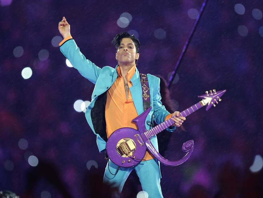 FILE - In this Feb. 4, 2007, file photo, Prince performs during the halftime show at the Super Bowl XLI football game at Dolphin Stadium in Miami. Thousands of Prince fans have signed a petition asking federal authorities to open a grand jury investigation into his 2016 death. (AP Photo/Chris O'Meara, File) Photo: Chris O'Meara, Associated Press