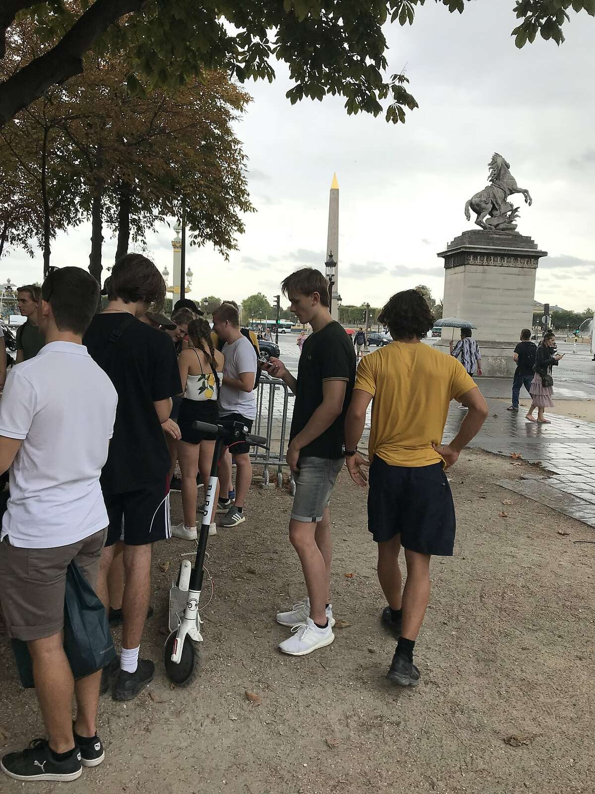 Danish students return a Bird scooter after a ride near the Place de La Concorde in Paris, France on September 25, 2018.