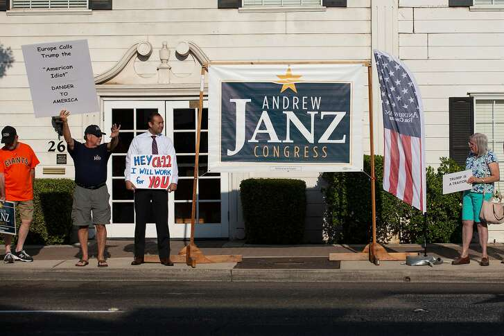 """CLOVIS, CA - JULY 17: Andrew Janz, 3rd from left, stands with supporters during the """"Every Tuesday Vigil"""" outside the office of Rep. Devin Nunes (R-CA) on July 17, 2018 in Clovis, California. The vigil, held by Janz supporters takes place every Tuesday outside of the office of Nunes. Janz is hoping to unseat Nunes in the November Congressional election. (Photo by Alex Edelman/Getty Images)"""