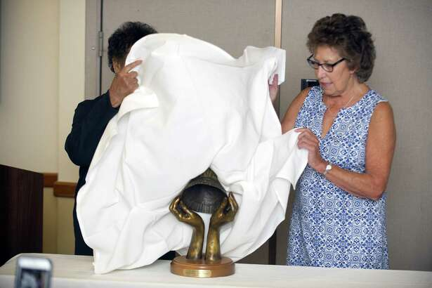 Stamford Hospital School of Nursing class of 1967 graduate Patricia Sileo Agostino, right, and class of 1969 graduate Brenda Peters Grant unveil the new statue celebrating Stamford nurses past and present during a ceremony inside Stamford Hospital in Stamford, Conn. on Wednesday, Sept. 25, 2018. The hospital?'s School of Nursing was established in 1901 and closed in 1976, and the statue will be housed inside the hospital.
