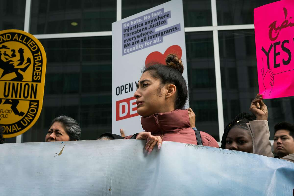 Daniela Cardona, 24, of Richmond, reacts during a press conference requesting temporary injunction of the Trump administration's decision to end Temporary Protected Status (TPS) for people from four countries, including Sudan, Nicaragua, Haiti and El Salvador at Phillip Burton Federal Building in San Francisco on Tuesday, September 25, 2018.