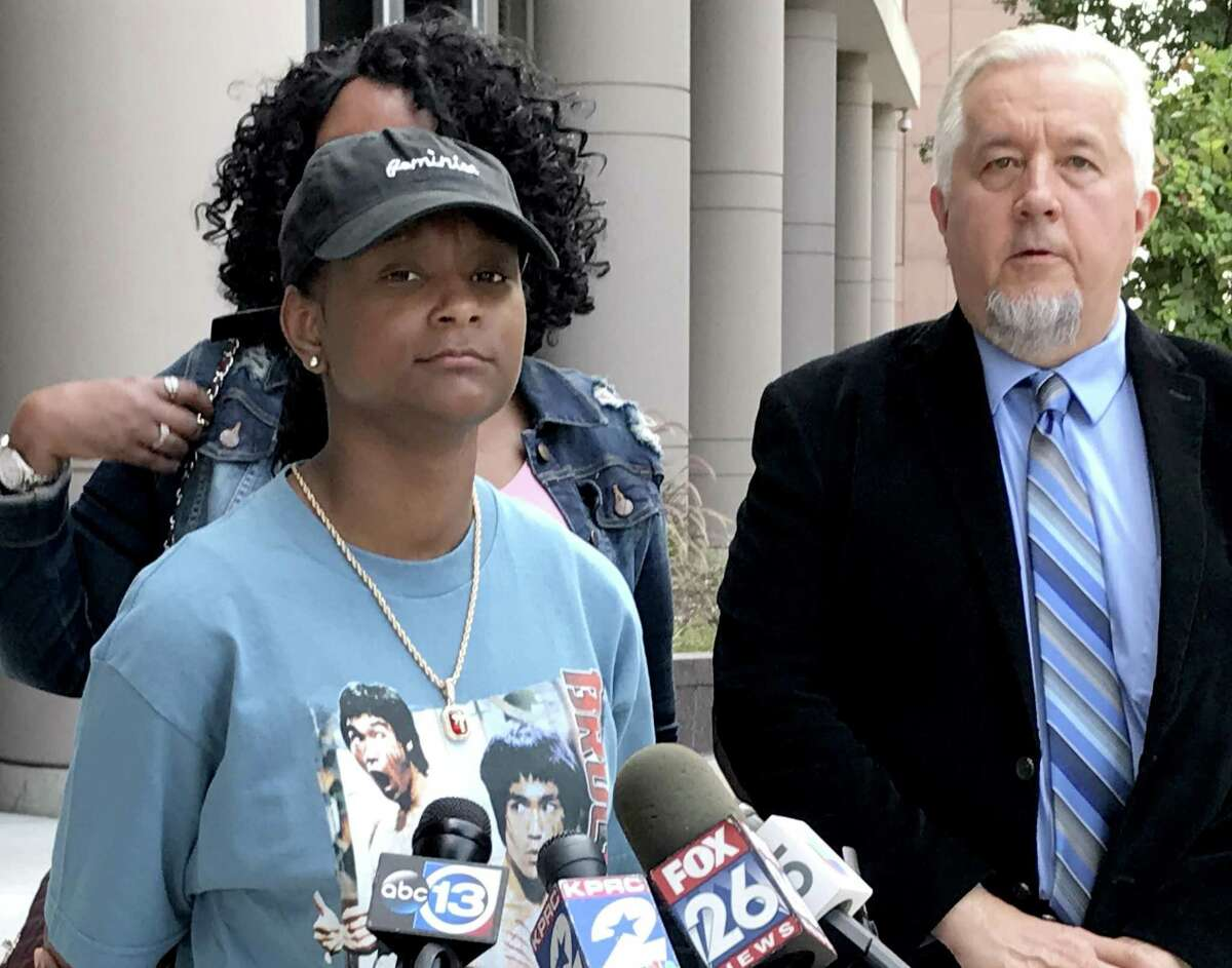 India Landry, 18, at a news conference outside the federal courthouse in Houston on July 19, 2018, as her attorney Randall L. Kallinen announces her lawsuit will move forward. The Landry family sued Cypress-Fairbanks ISD after India was expelled for sitting during the pledge of allegiance. >>How Colin Kaepernick's protests set off a national debate...
