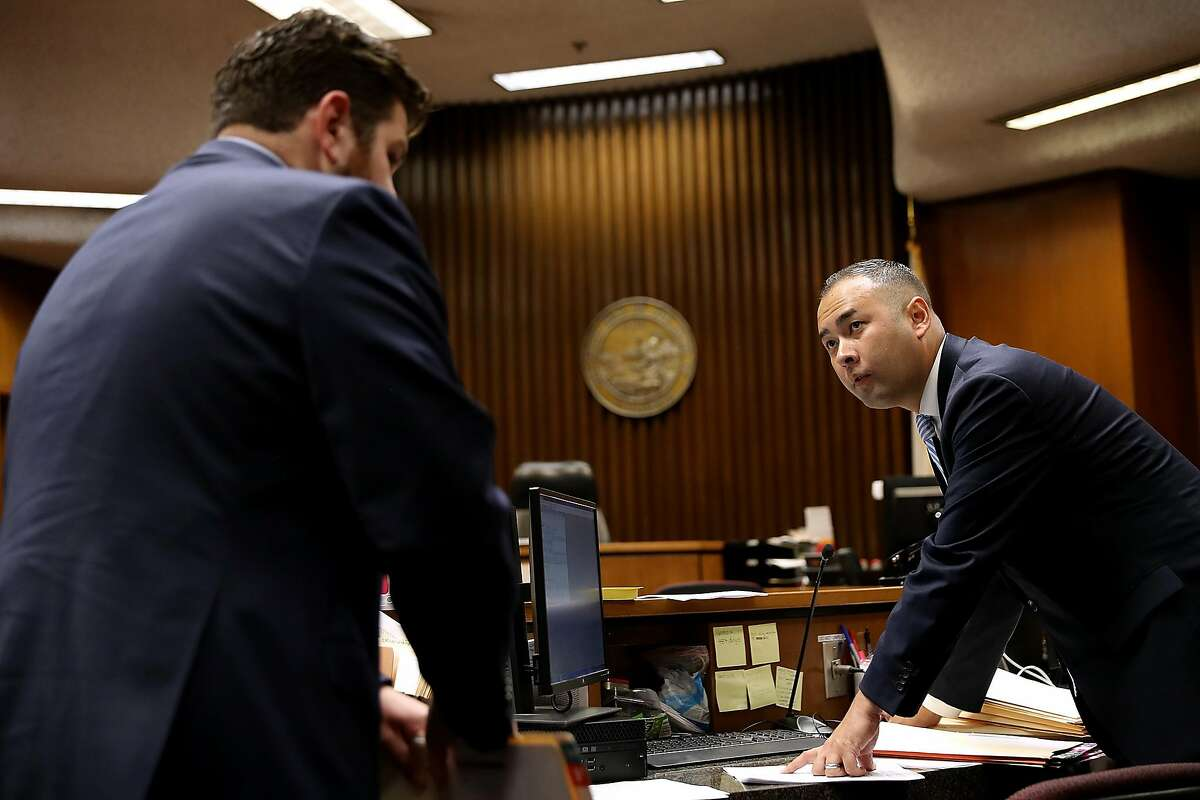 FRESNO, CA - JULY 31: Fresno County deputy district attorney and democrat U.S. Rep. candidate from California Andrew Janz talks with colleagues in court on July 31, 2018 in Fresno, California. Fresno County deputy district attorney Andrew Janz, a Democrat, is hoping to unseat Republican U.S. Rep. Devin Nunes (R-CA) in California District 22 in Central California. (Photo by Justin Sullivan/Getty Images)