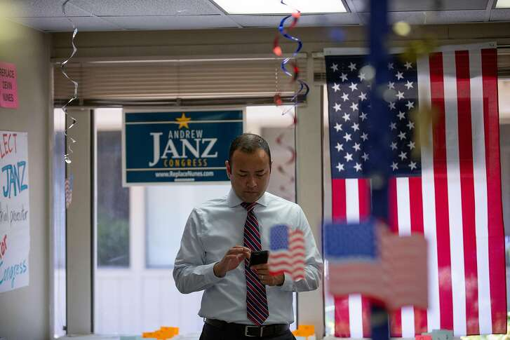 Fresno, CA - JULY 17: Fresno County Prosecutor Andrew Janz checks his phone at the Janz for Congress campaign office on July 17, 2018 in Fresno, California. Janz is hoping to unseat Nunes in the November Congressional election. (Photo by Alex Edelman/Getty Images)
