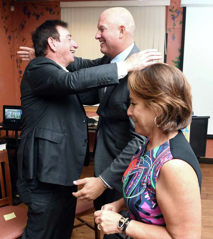 Len Schleifer (left) hugs Michael Storz, president of the Chapel Haven Schleifer Center, after Schleifer's wife, Harriet (bottom), announced a gift of $5 million for the Schleifer Adult Independent Living facility on September 25, 2018 at the center in New Haven. The facility is second phase of the campus expansion. Photo: Arnold Gold / Hearst Connecticut Media / New Haven Register