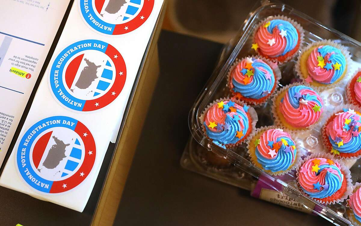 Cupcakes and stickers for National Voter Registration day displayed at Alliant International University Hurwich Library near pier 39 on Tuesday, Sept. 25, 2018 in San Francisco, Calif. National Voter Registration Day is Tuesday, and the big push before the November mid-term election begins in earnest.at Alliant International University Hurwich Library