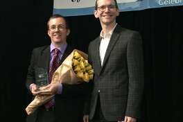 Mike Morath, Texas Commissioner of Education, right, stands next to Texas Teacher of the year, Jeff Wheatcraft of Alamo Heights Junior School.